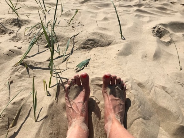 Toes in the sand on Sandbanks beach